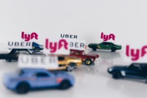 Uber and Lyft toy cars.