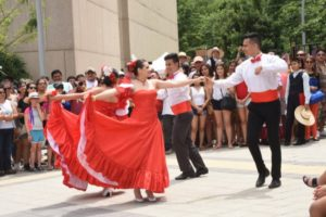 Men and women dancing.