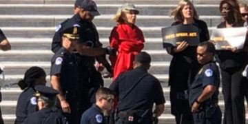 Jane Fonda being arrested.