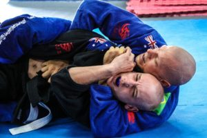 Two men practicing jiu-jitsu.