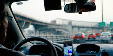 A man driving with GPS system turned on.