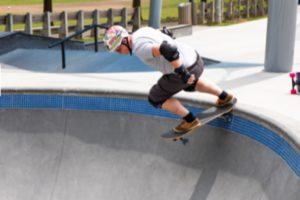 A man skating over a ramp.