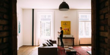 A man standing in the living room of an apartment