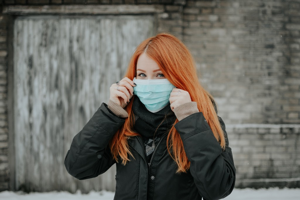 A woman wearing a surgical mask on the street