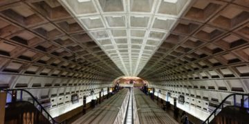 Two metro cars stopped at the Smithsonian Metro station in D.C.