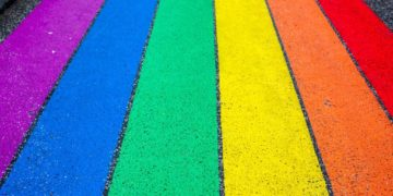 Colors of the LGBTQ Pride flag on the street.