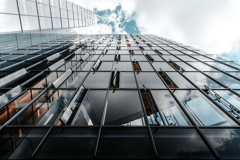 A building with reflection on its windows.