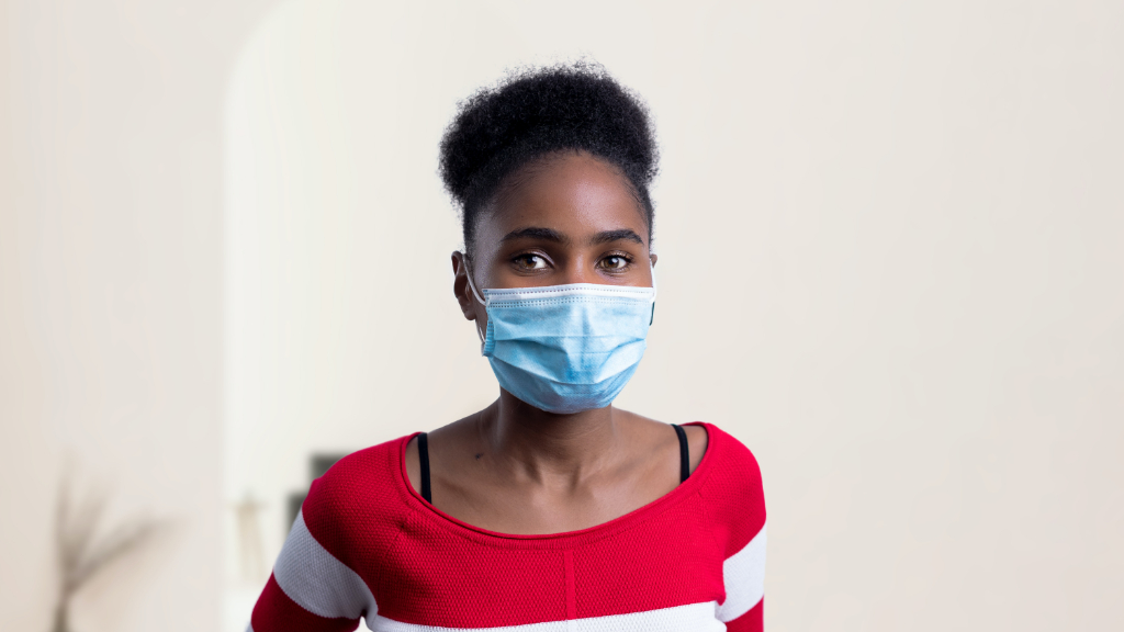 A Black woman wearing a face mask.