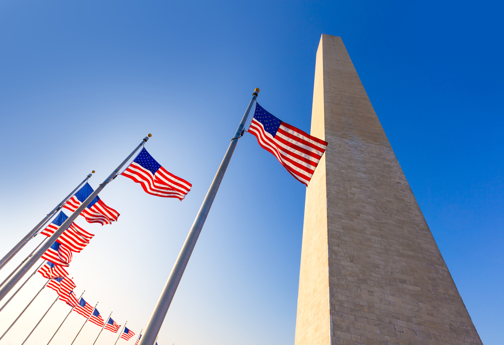 The Washington Monument and American flags.